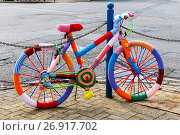 Купить «Bicycle with knitted covers, parked and secured against a chain fence next to a main road, Troon, Ayrshire.», фото № 26917702, снято 18 февраля 2020 г. (c) age Fotostock / Фотобанк Лори
