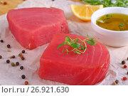 Купить «tuna fish steaks on cutting board», фото № 26921630, снято 25 февраля 2020 г. (c) Oksana Zh / Фотобанк Лори