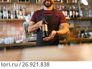 Купить «happy man or bartender with bottle of wine at bar», фото № 26921838, снято 8 декабря 2016 г. (c) Syda Productions / Фотобанк Лори
