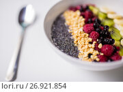 Купить «bowl of yogurt with fruits and seeds», фото № 26921854, снято 8 декабря 2016 г. (c) Syda Productions / Фотобанк Лори