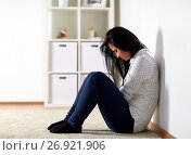 Купить «unhappy woman crying on floor at home», фото № 26921906, снято 20 января 2017 г. (c) Syda Productions / Фотобанк Лори
