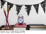 Купить «Books on the table against white blackboard with graphics», фото № 26922078, снято 21 февраля 2020 г. (c) Wavebreak Media / Фотобанк Лори