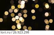 Купить «blurred chtistmas lights over dark background», видеоролик № 26923298, снято 9 сентября 2017 г. (c) Syda Productions / Фотобанк Лори