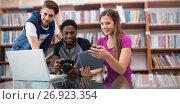Купить «Composite image of creative young business team looking at digital tablet», фото № 26923354, снято 16 февраля 2019 г. (c) Wavebreak Media / Фотобанк Лори