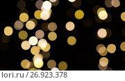 blurred chtistmas lights over dark background. Стоковое видео, видеограф Syda Productions / Фотобанк Лори