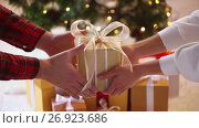 Купить «hands giving and receiving christmas gift box», видеоролик № 26923686, снято 11 сентября 2017 г. (c) Syda Productions / Фотобанк Лори
