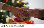 Купить «hands of couple with diamond ring at christmas», видеоролик № 26923878, снято 9 сентября 2017 г. (c) Syda Productions / Фотобанк Лори