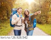 Купить «smiling couple with backpacks hiking», фото № 26928542, снято 31 августа 2014 г. (c) Syda Productions / Фотобанк Лори