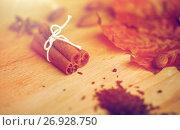 Купить «cinnamon, maple leaf and almond on wooden board», фото № 26928750, снято 13 октября 2016 г. (c) Syda Productions / Фотобанк Лори