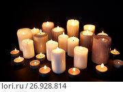 Купить «candles burning in darkness over black background», фото № 26928814, снято 20 марта 2017 г. (c) Syda Productions / Фотобанк Лори