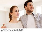 Купить «happy couple at new home», фото № 26928870, снято 4 июня 2017 г. (c) Syda Productions / Фотобанк Лори