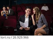 Купить «Couple interacting in theatre», фото № 26929966, снято 20 апреля 2017 г. (c) Wavebreak Media / Фотобанк Лори