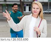 Купить «Husband and wife are emotional quarreling», фото № 26933690, снято 10 августа 2017 г. (c) Яков Филимонов / Фотобанк Лори