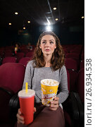 Купить «Woman watching movie in theatre», фото № 26934538, снято 20 апреля 2017 г. (c) Wavebreak Media / Фотобанк Лори
