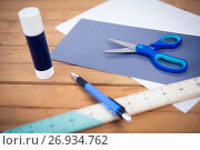 Купить «Close up of scissor on papers with school supplies», фото № 26934762, снято 26 мая 2017 г. (c) Wavebreak Media / Фотобанк Лори