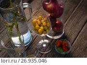Купить «High angle view of winter cherry and apples in container», фото № 26935046, снято 11 апреля 2017 г. (c) Wavebreak Media / Фотобанк Лори