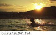 Купить «Little beautiful girl plays in warm summer sea», видеоролик № 26941194, снято 12 октября 2016 г. (c) BestPhotoStudio / Фотобанк Лори