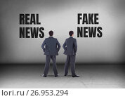 Купить «Real news or fake news with Businessman looking in opposite directions», фото № 26953294, снято 3 августа 2020 г. (c) Wavebreak Media / Фотобанк Лори