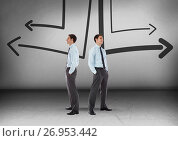 Купить «Left or right arrows drawings with Businessman looking in opposite directions», фото № 26953442, снято 23 августа 2019 г. (c) Wavebreak Media / Фотобанк Лори