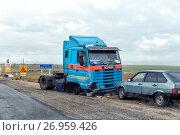 Купить «Elista, Russia - September 23, 2016: Road accident involving a truck», фото № 26959426, снято 23 сентября 2016 г. (c) Евгений Ткачёв / Фотобанк Лори