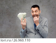 Купить «greedy businessman with american dollar money», фото № 26960110, снято 6 мая 2017 г. (c) Syda Productions / Фотобанк Лори