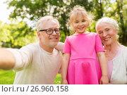 Купить «senior grandparents and granddaughter selfie», фото № 26960158, снято 9 августа 2017 г. (c) Syda Productions / Фотобанк Лори