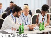 Купить «happy business team at international conference», фото № 26960222, снято 27 августа 2017 г. (c) Syda Productions / Фотобанк Лори