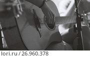 Купить «Musician in night club - guitarist plays blues acoustic guitar, extremely close up - black and white», фото № 26960378, снято 26 апреля 2018 г. (c) Константин Шишкин / Фотобанк Лори