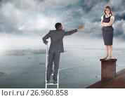 Купить «Businessman on ladder reaching for help to Businesswoman standing on Roof with chimney and cloudy ci», фото № 26960858, снято 20 июля 2018 г. (c) Wavebreak Media / Фотобанк Лори