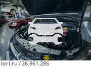 Купить «Car and wrench icon against repair shop», фото № 26961286, снято 13 декабря 2018 г. (c) Wavebreak Media / Фотобанк Лори