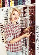 Купить «mature woman in sewing store», фото № 26961738, снято 23 мая 2019 г. (c) Яков Филимонов / Фотобанк Лори