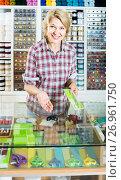 Купить «woman seller standing at counter with various scissors in sewing store», фото № 26961750, снято 16 августа 2018 г. (c) Яков Филимонов / Фотобанк Лори