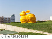 Baku, Azerbaijan - September 24, 2016: Big colorful rabbit on green lawn as elements of landscape design near Heydar Aliyev Center, the building designed by world-famous architect Zaha Hadid, фото № 26964894, снято 24 сентября 2016 г. (c) Евгений Ткачёв / Фотобанк Лори