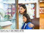 Купить «Mother and daughter enjoying expositions of previous centuries», фото № 26969478, снято 12 декабря 2017 г. (c) Яков Филимонов / Фотобанк Лори