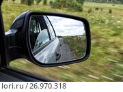 Купить «Side view mirror reflection on the road», фото № 26970318, снято 7 августа 2016 г. (c) Евгений Ткачёв / Фотобанк Лори