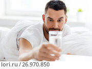 Купить «man in bed with glass of water at home», фото № 26970850, снято 6 мая 2017 г. (c) Syda Productions / Фотобанк Лори