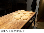 Купить «yeast bread dough on bakery kitchen table», фото № 26970894, снято 15 мая 2017 г. (c) Syda Productions / Фотобанк Лори