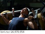 Купить «man doing chest press on exercise machine in gym», фото № 26970954, снято 2 июля 2017 г. (c) Syda Productions / Фотобанк Лори