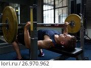 Купить «young man flexing muscles with barbell in gym», фото № 26970962, снято 2 июля 2017 г. (c) Syda Productions / Фотобанк Лори