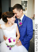 Купить «Charming couple bride and groom in the lobby laughing and genuinely smiling positive portrait. Sincere feelings, strong emotions. Wedding bouquet in hands, all in one color scheme.», фото № 26973430, снято 31 июля 2015 г. (c) Евгений Майнагашев / Фотобанк Лори