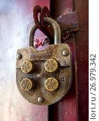 Купить «Механический кодовый замок с круглыми кодовыми элементами», фото № 26979342, снято 7 июня 2017 г. (c) Вячеслав Палес / Фотобанк Лори