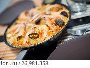 Купить «Traditional Spanish rice dish with seafood - paella», фото № 26981358, снято 23 января 2016 г. (c) Яков Филимонов / Фотобанк Лори