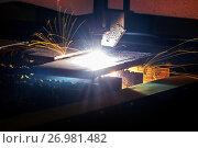 Купить «CNC plasma cutting machine during operation.», фото № 26981482, снято 15 июня 2017 г. (c) Андрей Радченко / Фотобанк Лори