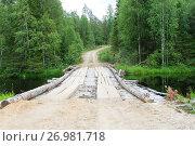 Купить «Лесная дорога и деревянная переправа через речку на севере Карелии», фото № 26981718, снято 30 июля 2017 г. (c) Лариса Капусткина / Фотобанк Лори