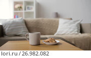 Купить «chocolate oatmeal cookies and mug with hot drink», видеоролик № 26982082, снято 20 сентября 2017 г. (c) Syda Productions / Фотобанк Лори