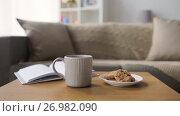 Купить «chocolate oatmeal cookies and mug with hot drink», видеоролик № 26982090, снято 20 сентября 2017 г. (c) Syda Productions / Фотобанк Лори