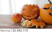 Купить «jack-o-lantern or carved halloween pumpkins», видеоролик № 26982110, снято 20 сентября 2017 г. (c) Syda Productions / Фотобанк Лори