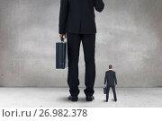 Купить «Big and small business men standing», фото № 26982378, снято 12 декабря 2018 г. (c) Wavebreak Media / Фотобанк Лори