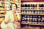 Woman choosing honey in store, фото № 26991202, снято 26 сентября 2017 г. (c) Яков Филимонов / Фотобанк Лори