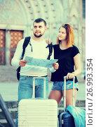 Купить «Family tourists with map and baggage», фото № 26993354, снято 25 мая 2017 г. (c) Яков Филимонов / Фотобанк Лори